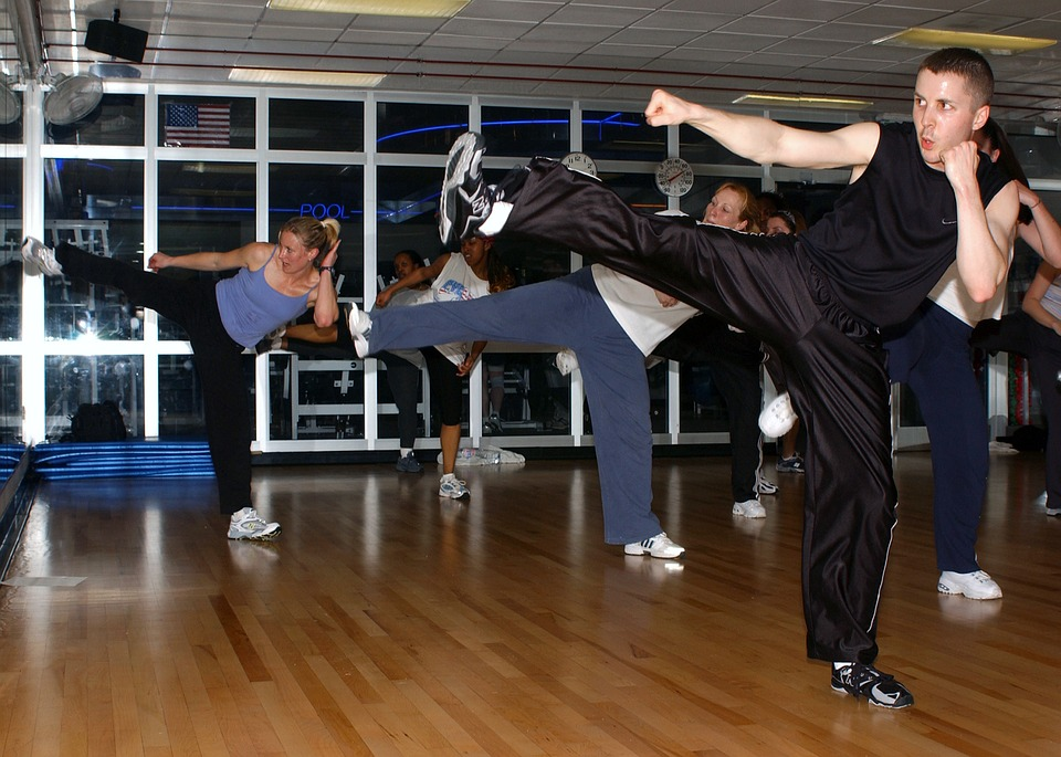 men practicing kickboxing