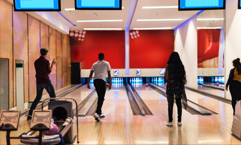bowlers in a bowling alley